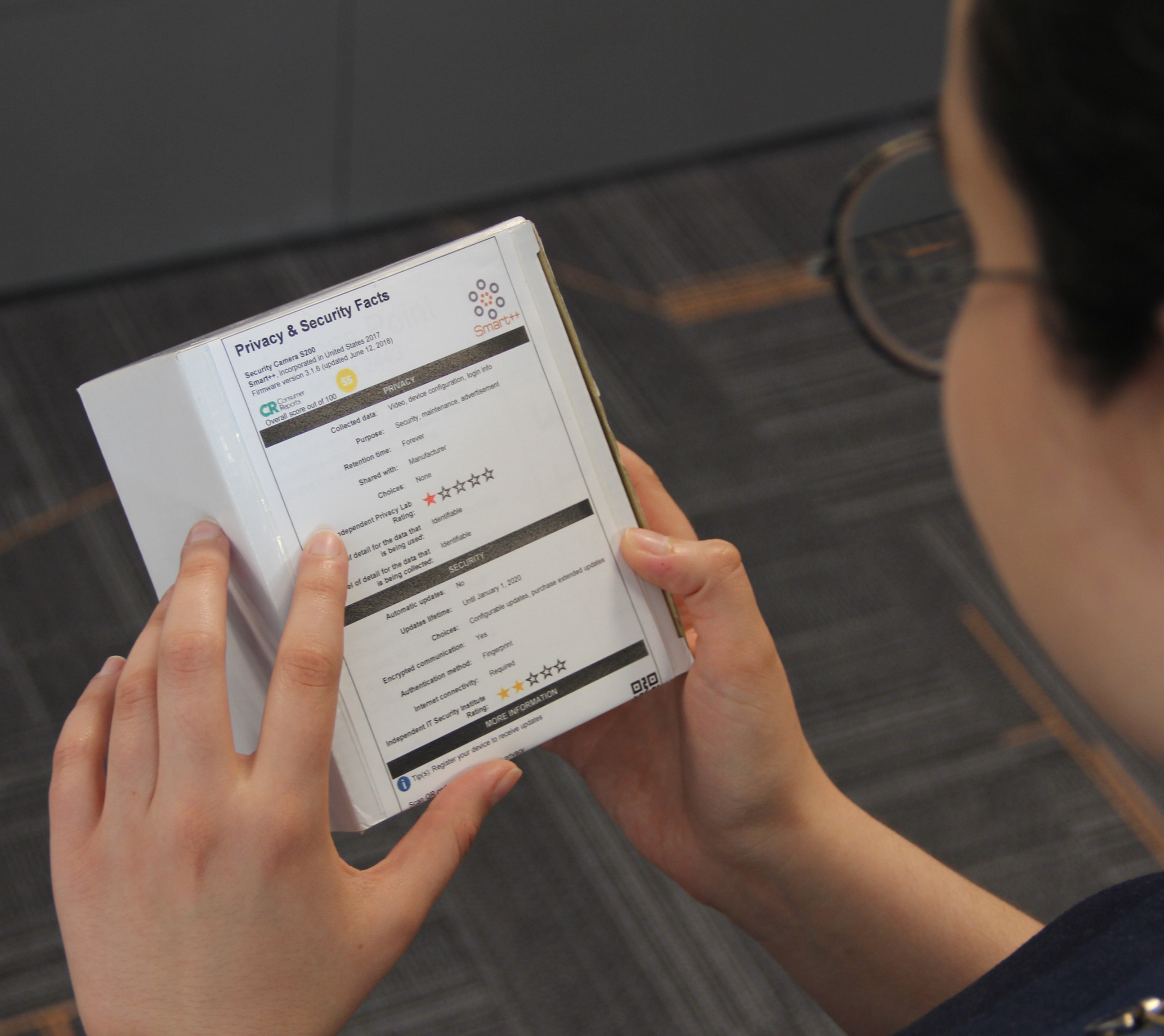 "Person holding tablet showing ""privacy label"""